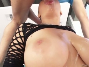 Sexy Marina Visconti in a fishnet top shows her titties as she gets her mouth...
