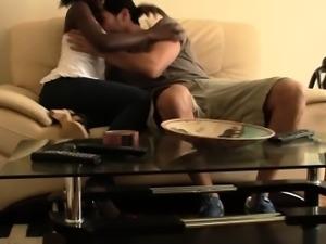 Ebony babe fucking big white cock doggy style on couch