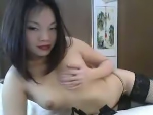 Wicked and hot Asian webcam babe masturbates with a vibrator