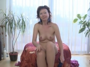 Raunchy mature hussy Nitouche has some fun with a sex toy