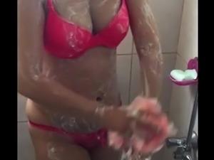 TAKING SHOWER IN BATHROOM