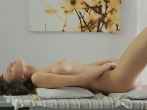 Amazing looking girl gets naked and massages her clit