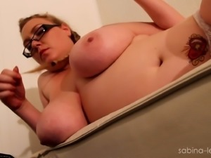 Blonde BBW Sabina Leigh smokes and plays with her huge natural tits