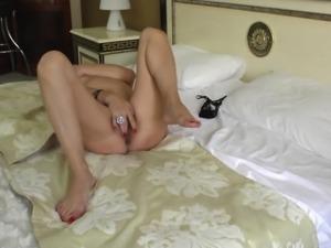 Old babe puts aside her magazine and masturbates tenderly