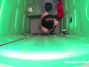 Teen swallows strangers cum in porta potty gloryhole in public parking lot