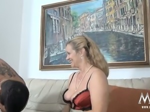 Old light haired slut with big saggy boobs blows stiff dick of young man...