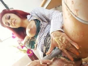 Nasty girls rubbing each other with cake and toy fucking passionately in...