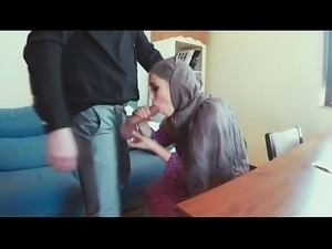 Robed Up Arab Honey Sucking On Dudes Dong From Floor