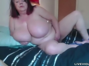 She is a big horny woman with big knockers who loves masturbating on cam