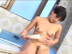 Solo model with natural tits masturbating while taking shower