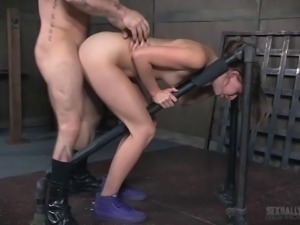 Handsome hunk bends over a brunette sex slave for a fuck