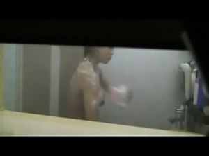Hot busty asian caught taking a shower by a window peeper
