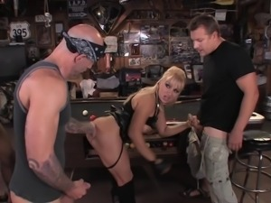 Dirty slut in the bar invites three guys to fuck her