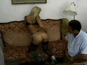 Hot temptress Nikki Anderson knows how to service two stiff cocks at once