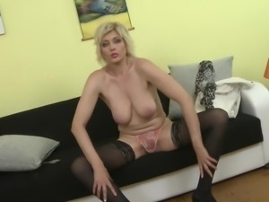 blonde sandra strips and shows off her big tits