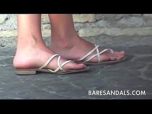 candid beautiful italian girl with her sandals