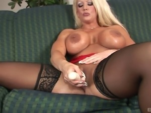 Mature blonde chick with huge fun bags has fun with big toys
