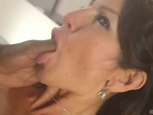 Mature maid knows how to please a bulky black schlong