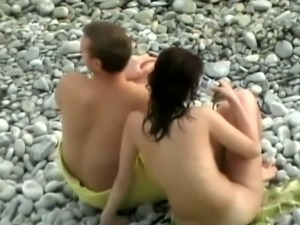 Amateur couple had a great time while spooning each other on beach