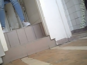 Lovely amateur lady in blue jeans filmed in the public restroom