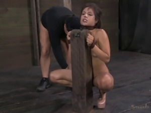 Tattooed bondage slave stripped seductively in BDSM shoot