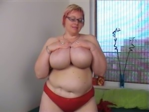 Marvelous blonde BBW mature woman jiggles her big breasts