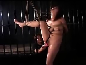 Buxom Oriental nympho gets her superb body tied up and cove