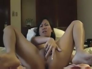 Asian girl fingering and squirting
