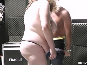 Big melons curly woman spreads legs at work