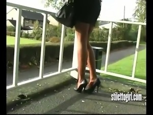 Hot babe teases legs in short skirt sexy nylon and stilettos