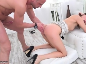 While all her holes get devastated by his big cock, this horny babe keeps...
