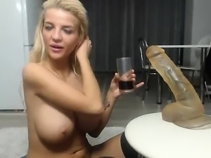 Big titted MILF plays with her bulbous boobs