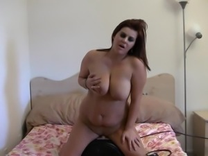 Curvy brunette fucks a sex machine with her moist pussy