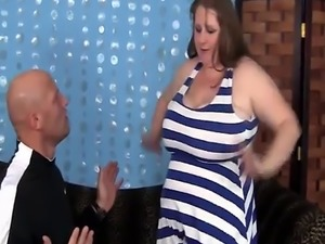 A brunette BBW with extremely large tits sucks hard penis and gets her
