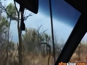 Beautiful African babe sucking big white cock inside the car