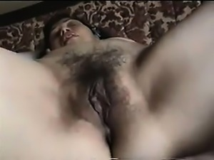 Mature amateur spreads her extreme hairy pussy