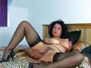Beautiful woman masturbates vibrator on the bed