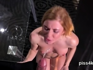Pretty girl is geeting pissed on and squirts wet vagina