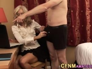Amateur milf tugs cock