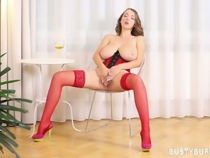 Fantastic looking all alone busty babe in corset uses a dildo to pet herself