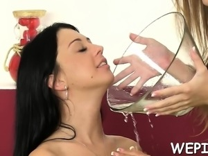 Bitchy gals give a foot job to every other and make pissing