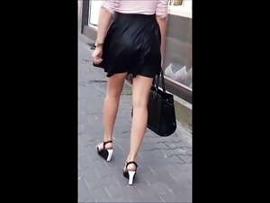 #50 Girl with sexy legs in leather skirt and wedges